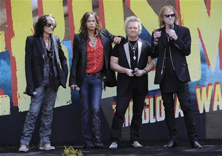 Joe Perry (L-R), Steven Tyler, Joey Kramer, and Tom Hamilton of the band Aerosmith answer questions during an announcement of their Global Warming Tour in Los Angeles on March 28, 2012. REUTERS/Phil McCarten