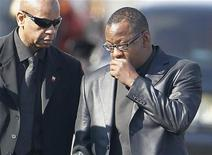 Bobby Brown (R) leaves the funeral service of ex-wife pop singer Whitney Houston at the New Hope Baptist Church in Newark, New Jersey February 18, 2012. REUTERS/Carlo Allegri