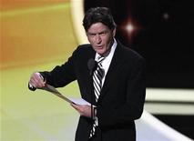 "Presenter Charlie Sheen announces the winner of the award for outstanding lead actor in a comedy series to actor Jim Parsons for television series ""The Big Bang Theory"" at the 63rd Primetime Emmy Awards in Los Angeles September 18, 2011. REUTERS/Mario Anzuoni"