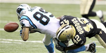 New Orleans Saints safety Isa Abdul-Quddus (42) strips the ball from Carolina Panthers wide receiver Steve Smith (89) during their NFL football game at The Mercedes-Benz Superdome in New Orleans, Louisiana January 1, 2012. REUTERS/Sean Gardner