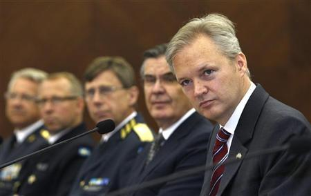 Swedish Defence Minister Sten Tolgfors (R) takes part in a meeting with his South Korean counterpart Kim Kwan-jin (not in picture) at the South Korean Defence Ministry in Seoul June 21, 2011. REUTERS/Truth Leem