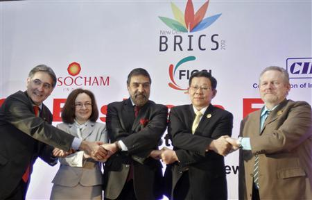 Brazilian Trade Minister Fernando Pimentel (L-R), Russia's Economic Development Minister Elvira Nabiullina, India's Trade Minister Anand Sharma, China's Minister of Commerce Chen Deming and South African Minister of Trade and Industry Rob Davies, shake hands during a group photograph at the BRICS Summit Forum themed ''BRICS Partnership for Stability, Security and Growth'' in New Delhi March 28, 2012. REUTERS/Vijay Mathur