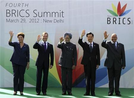 (From L-R) Brazil's President Dilma Rousseff, Russian President Dmitry Medvedev, Indian Prime Minister Manmohan Singh, Chinese President Hu Jintao and South African President Jacob Zuma wave during a group photo for the BRICS Summit in New Delhi March 29, 2012. REUTERS/B Mathur