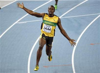 Usain Bolt of Jamaica celebrates winning the men's 4x100 metre relay final at the IAAF World Championships in Daegu September 4, 2011. REUTERS/Max Rossi/Files