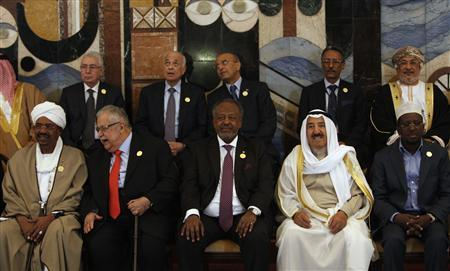 Arab leaders pose for a picture ahead of the opening session of the 23rd Arab League Summit in Baghdad March 29, 2012. REUTERS/Saad Shalash