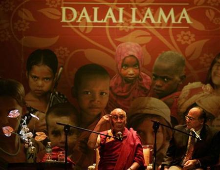 Tibet's exiled spiritual leader the Dalai Lama delivers a speech during a conference at the Coliseo Theater, next to translator Gerardo Abboud, in Buenos Aires September 13, 2011. REUTERS/Martin Acosta