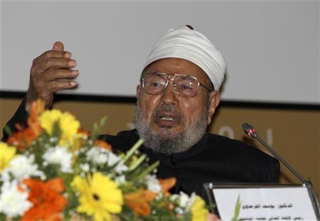 Sheikh Yusuf al-Qaradawi speaks during the first conference of the ''National Dialogue'' in Tripoli December 10, 2011. REUTERS/Ismail Zitouny