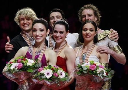 (L-R) Charlie White and Meryl Davis of the U.S., Scott Moir and Tessa Virtue of Canada, and Nathalie Pechalat and Fabian Bourzat of France celebrate on the podium at the medal ceremony of the ice dance free dance at the ISU World Figure Skating Championships in Nice March 29, 2012. REUTERS/Eric Gaillard