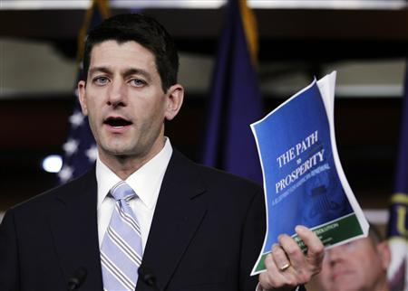 House Budget Chairman Paul Ryan (R-WI) shows a copy of the ''FY2013 Budget - The Path to Prosperity'' during a news conference at Capitol Hill in Washington March 20, 2012. REUTERS/Jose Luis Magana