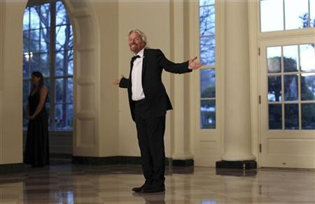 British billionaire Richard Branson arrives for a State Dinner held in honor of Britain's Prime Minister David Cameron and his wife Samantha at the White House in Washington March 14, 2012. REUTERS/Benjamin Myers