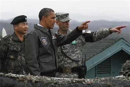 U.S. President Barack Obama visits U.S. military personnel stationed at Observation Post Ouellette along the Demilitarized Zone (DMZ) which borders North and South Korea, outside Seoul, March 25, 2012. REUTERS/Larry Downing