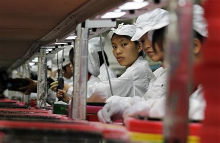 Workers are seen inside a Foxconn factory in the township of Longhua in the southern Guangdong province, in this file picture taken May 26, 2010. REUTERS/Bobby Yip/Files