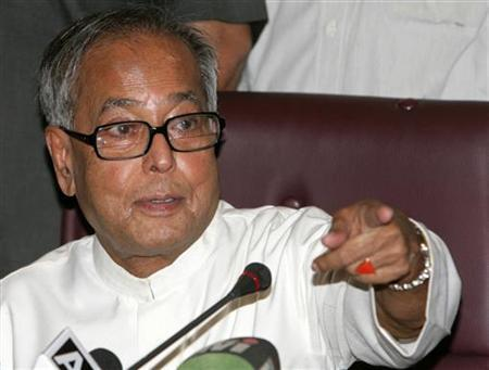 Finance Minister Pranab Mukherjee gestures during a news conference in New Delhi May 27, 2009. REUTERS/B Mathur/Files
