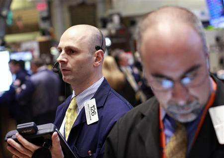 Traders work on the floor of the New York Stock Exchange, March 27, 2012. REUTERS/Brendan McDermid