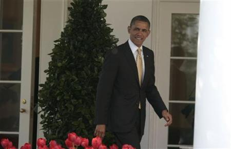 U.S. President Barack Obama walks out of the Oval Office to the Rose Garden of the White House in Washington, March 29, 2012. REUTERS/Larry Downing