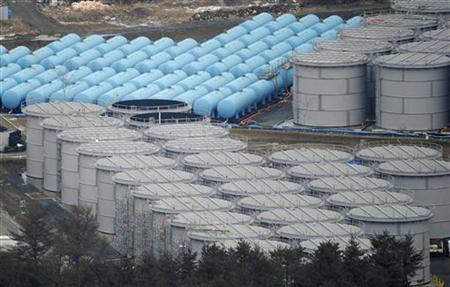 Tokyo Electric Power Co. (TEPCO)'s tsunami-crippled Fukushima Daiichi nuclear power plant's contaminated water storage tanks are seen in Fukushima prefecture, in this aerial view photo taken by Kyodo, March 11, 2012, the day marking the first anniversary of the earthquake and tsunami that killed thousands and set off a nuclear crisis. REUTERS/Kyodo
