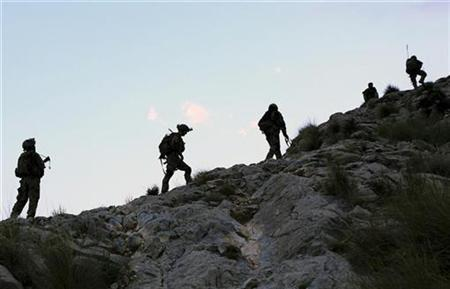 U.S. Army soldiers from Charlie Company's 2nd battalion 35th infantry regiment, Task Forces Bronco, climb during an early morning mountain patrol at the Chaw Kay district in Kunar province, eastern Afghanistan August 19, 2011. REUTERS/Nikola Solic