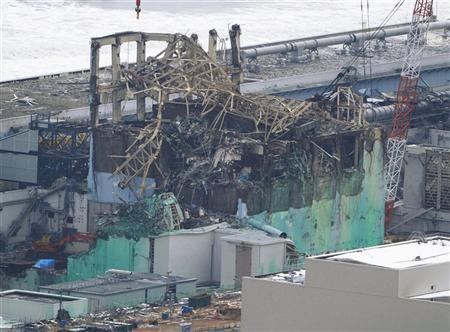 Tokyo Electric Power Co. (TEPCO)'s tsunami-crippled Fukushima Daiichi nuclear power plant's reactor building number 3 is seen in Fukushima prefecture, in this aerial view photo taken by Kyodo, March 11, 2012, the day marking the first anniversary of the earthquake and tsunami that killed thousands and set off a nuclear crisis. REUTERS/Kyodo