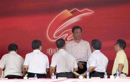 China's former Chongqing Municipality Communist Party Secretary Bo Xilai shakes hands with officials after the opening ceremony of a revolutionary song singing concert to celebrate the upcoming 90th anniversary of the founding of the Communist Party of China (CPC) on July 1, at Chongqing Olympic Sports Centre in Chongqing municipality June 29, 2011. REUTERS/Jason Lee