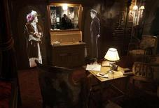 Images of people are projected on a wall in a replica first class cabin room in the Titanic Belfast building in Belfast, Northern Ireland March 27, 2012. REUTERS/David Moir