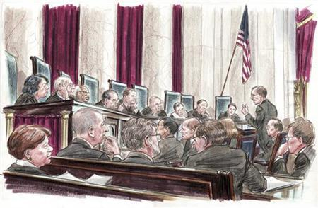 In this courtroom illustration, U.S. Solicitor General Donald Verrilli (R) speaks at the lectern to members of the U.S. Supreme Court in Washington March 27, 2012. REUTERS/Art Lien