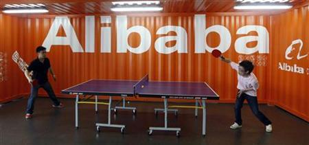 Employees play table tennis inside the headquarters office of Alibaba (China) Technology Co. Ltd on the outskirts of Hangzhou, Zhejiang province May 17, 2010. REUTERS/Steven Shi