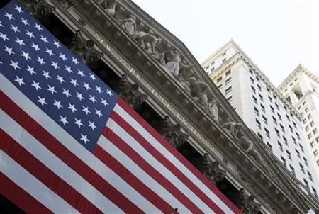 A flag is seen in front of the New York Stock Exchange building in New York August 12, 2011. REUTERS/Jessica Rinaldi