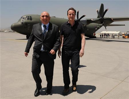 Britain's Prime Minister David Cameron arrives with British Ambassador Sir William Patey (L) before meeting with Afghanistan's President Hamid Karzai in Kabul June 10, 2010. REUTERS/Stefan Rousseau/POOL