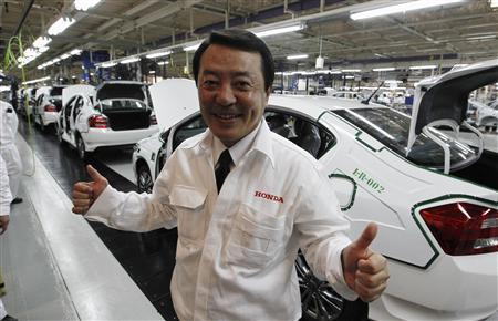 Hiroshi Kobayashi, president and chief executive of Asian Honda Motor Co Ltd, poses at a sedan line production at Honda Automobile in Rojana Industrial Park, Ayutthaya province, about 80 km (50 miles) north of Bangkok March 31, 2012. REUTERS/Sukree Sukplang