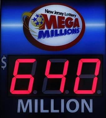 A storefront sign displays the jackpot total of Friday's Mega Millions lottery in Hoboken, New Jersey, March 30, 2012. REUTERS/Gary Hershorn