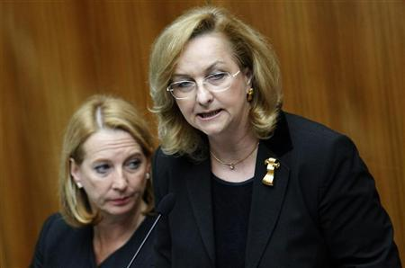 Austrian Finance Minister Maria Fekter (R) delivers a speech next to Infrastructure Minister Doris Bures during a session of the parliament in Vienna March 28, 2012. REUTERS/Lisi Niesner