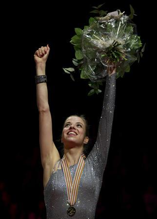 Carolina Kostner of Italy celebrates on the podium during the medal ceremony after winning the women's free skating event at the ISU World Figure Skating Championships in Nice March 31, 2012. REUTERS/Eric Gaillard