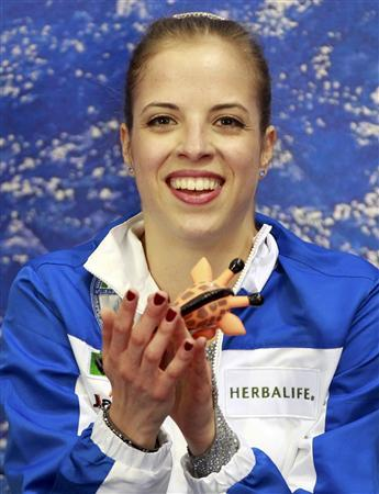 Carolina Kostner of Italy reacts after performing during the women's free skating event at the ISU World Figure Skating Championships in Nice March 31, 2012. REUTERS/Eric Gaillard