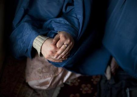A woman addict sits cross-legged during a counseling session at the Nejat drug rehabilitation centre, an organisation funded by the United Nations providing harm reduction and HIV/AIDS awareness, in Kabul January 29, 2012. REUTERS/Ahmad Masood