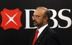 DBS Bank's CEO Piyush Gupta walks in front of the bank's logo after a news conference in Singapore in this May 7, 2010 file photo. After two years of hard work to improve Singapore's largest bank and lift its underperforming Hong Kong unit, DBS Group chief executive Gupta is embarking on his biggest challenge yet - a bid for Indonesia's Bank Danamon. Picture taken May 7, 2010. REUTERS/Vivek Prakash/Files