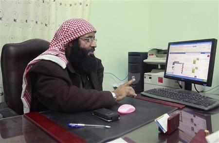 Salafi sheikh, Marai Arar, talks during an interview with Reuters at his office in Rafah, March 5, 2012. Marai Arar, a Salafi leader who heads religious courts in north Sinai, was detained for eight years, like many Islamists during Hosni Mubarak's time before the uprising. With Mubarak's removal from power after three decades, the government authority has collapsed in much of Sinai with the Islamists taking over. Picture taken March 5, 2012. REUTERS/Asmaa Waguih