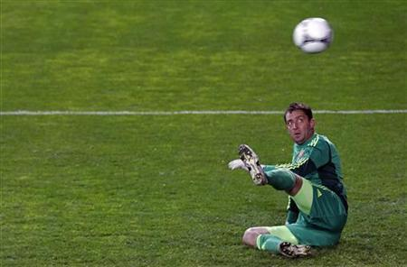 Ukraine's goalkeeper Andriy Dykan looks on as the ball goes into his frame on a penalty during their international friendly soccer match in Petach Tikva near Tel Aviv February 29, 2012. REUTERS/ Nir Elias/Files