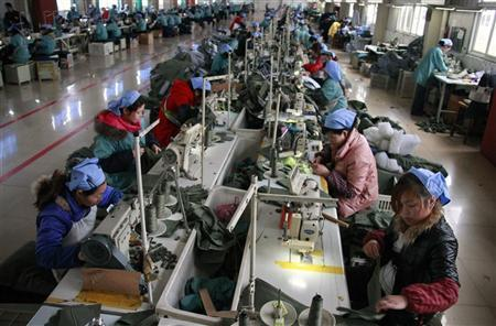 Labourers work at a garment factory in Huaibei, Anhui province March 23, 2012. REUTERS/Stringer