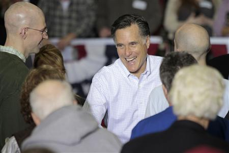 U.S. Republican presidential candidate Mitt Romney greets members of the crowd after addressing supporters at the InPro Corporation in Muskego, Wisconsin, March 31, 2012. REUTERS/Darren Hauck