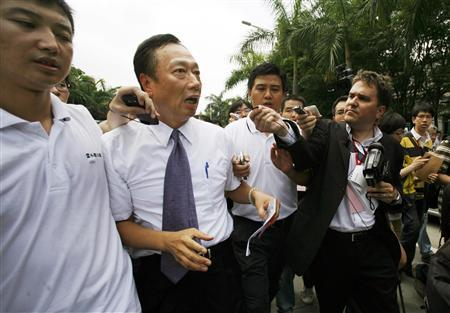 Taiwanese tycoon Terry Gou (2nd L), founder of Foxconn, speaks to journalists as he visits a Foxconn factory in the township of Longhua in the southern Guangdong province in this May 26, 2010 file photo. Foxconn Technology Group will keep on increasing worker salaries in China and cutting the hours of work, Gou said on April 1, 2012, after it came under fire for poor working conditions for employees making Apple iPhones and iPads. Picture taken May 26, 2010. REUTERS/Bobby Yip/Files