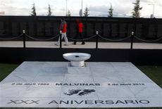 "Visitors read the names of the fallen Argentine soldiers during Falkland Islands War on a Malvinas Cenotaph in Ushuaia April 1, 2012. April 2 marks the 30th anniversary of the war over the island chain, known commonly in Argentina as ""Las Malvinas"". Diplomatic tensions have surged in recent months ahead of the 30th anniversary of the brief war which left about 1,000 people killed before Argentina surrendered to the British on June 14, 1982. The two countries fought over the South Atlantic archipelago, and the Falklands' assembly said it was hard to trust Argentina. REUTERS/Enrique Marcarian"