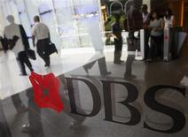 People walk in the lobby of a DBS Bank building in Singapore, in this November 7, 2008 file picture. REUTERS/Vivek Prakash/Files