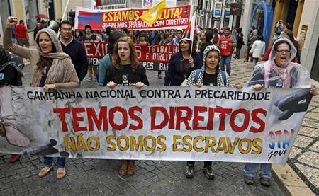 Youth march with a banner saying ''We have rights, we are not slaves'' during a protest against unemployment and government austerity measures in Lisbon March 31, 2012. REUTERS/Jose Manuel Ribeiro