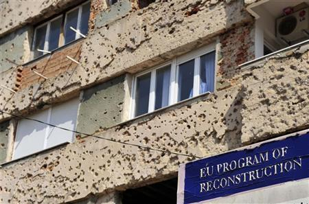 A bullet riddled building is seen is seen before being repaired under an European Union reconstruction programme in Mostar March 29, 2012.  REUTERS/Srdjan Zivulovic