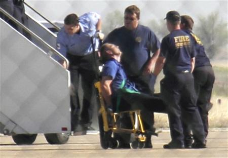 Captain Clayton Osbon is removed from a JetBlue passenger jet in Amarillo, Texas in this March 27, 2012 file photo. REUTERS/Steve Miller/The Reporters Edge/Files