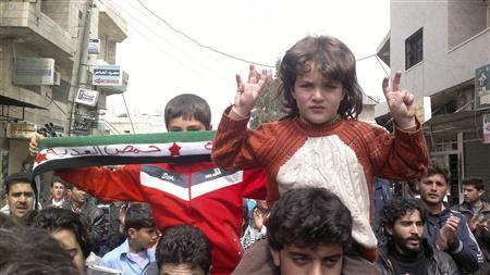 Demonstrators protest against Syria's President Bashar al-Assad in Kafranbel, near Idlib April 1, 2012. REUTERS/Raad Al Fares/Shaam News Network/Handout