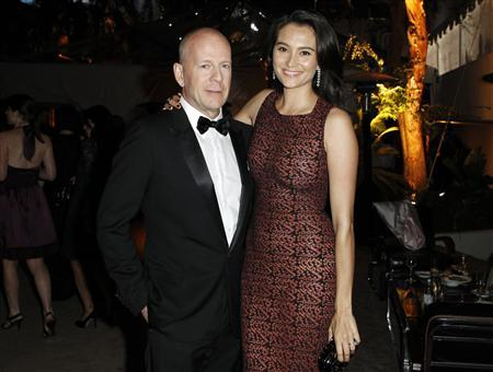 Actor Bruce Willis (L) and his wife Emma Heming pose at The Weinstein Company and Relativity Media's after party for the 68th annual Golden Globe Awards in Beverly Hills, California January 16, 2011. Reuters/Danny Moloshok