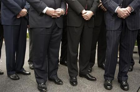 Chief Executives wait to speak to the media at the White House after a meeting about the economy in Washington, March 27, 2009. REUTERS/Larry Downing