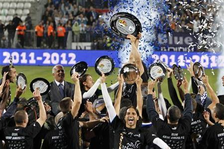 Players of Hapoel Ironi Kiryat Shmona F.C celebrate after winning a match against Hapoel Tel Aviv to win the championship for the Israeli Premier league in Kiryat Shmona April 2, 2012. REUTERS/ Nir Elias