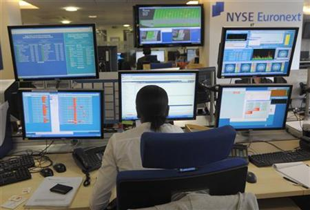 An expert works at her screens in the NYSE Euronext cash markets operations room in Paris August 19, 2011. REUTERS/Philippe Wojazer/Files